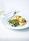 Piece of gremolata pollock,tagliatelles with zucchinis and tomatoes