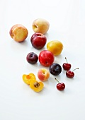 Assortment of summer fruits on a white background