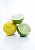 Lemons and limes on a white background