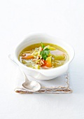 Vegetables broth with olive oil and lardons