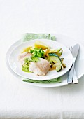 Claresse fish in watercress sauce, steamed vegetables with onions