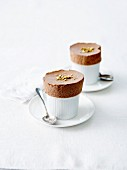 Chocolate souffle topped with crushed pistachios