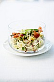 Farfalle, green asparagus, and thinly sliced raw ham salad