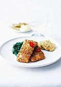Caramelized salmon in sesame crust, spinach