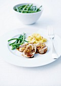 Veal Filet mignon stuffed with dried fruit, green beans and potatoes