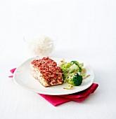 Piece of salmon in pink peppercorn crust, broccolis
