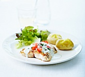Grilled pollock fillet, loght creamy sauce and diced fresh tomatoes