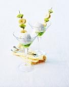 Coconut ice cream with kiwi jelly, kiwi-banana brochettes