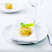 Uncookes tagliatelle nest and name-tag