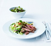 Thinly sliced grilled beef fillet with slimming salad