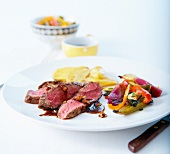 Beef fillet with fig gravy and summer vegetables