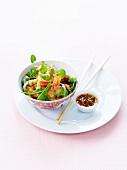 Warm spicy shrimp salad with chili peper sauce