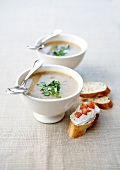 Cold creamed celery soup with cream cheese on sliced baguette