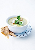 Creamed 7 vegetable soup with crisp bacon and cream