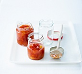 Small jars of preserved tomato sauce