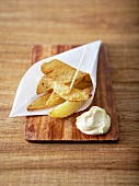 Small cone of homemade french fries and truffle-flavored mayonnaise