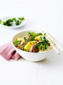 Bowl of sauteed beef with pineapple and sugar peas, white rice