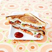 Italian-style tomato-mozzarella-raw ham toasted sandwich