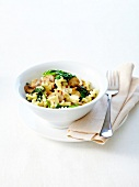 Pasta with mushrooms, fresh spinach and chili pepper