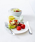Grilled avocado with crispy steaky bacon and pan-fried cherry tomatoes