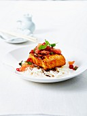 Piece of salmon caramelized with soya sauce,pink grapefruit,chili pepper and rice vermicellis