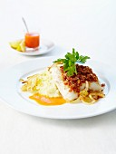 Piece of cod topped with crisp breadcrumbs and tomatoes,homemade mashed potatoes