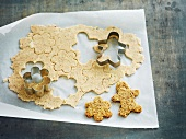 Cutting out shapes in the dough with a biscuit cutter for cookies
