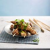 Rabbit, zucchini and sesame seed skewers