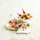 Raw radish-melon-raw ham bites, goat's cheese-zucchini-cherry tomato cake bites, buckwheat and salmon rolls