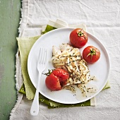 Steamed piece of cod with thyme, onions and cherry tomatoes