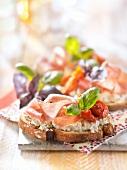 Philadelphia cream cheese, raw ham and sun-dried tomatoes on sliced bread