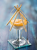 Pineapple-coconut mousses with white chocolate Mikados
