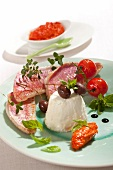 Goatfish fillets with cream cheese, olives and red tomato tapenade