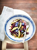 Red cabbage, walnut, borage flowers and apple salad