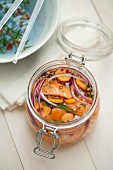 Jar of marinated salmon with seasonings