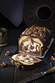 Chocolate marble cake topped with caramelized walnuts