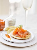 Blini topped with smoked salmon and salmon roe
