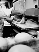 Person preparing bread