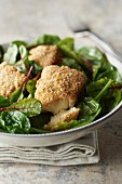 Crispy melting Camembert with baby spinach salad