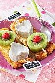 Cheese hearts and kiwi on sliced brioche