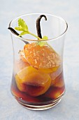 Poached apricots in vanilla-flavored blackcurrant syrup
