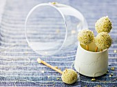 Matcha tea balls coated in sesame seeds breadstick pops