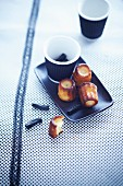 Cannelés (traditional cakes with a caramel crust, Bordeaux) with liquorice