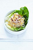 Noodle,beef and citronella salad served in a lettuce leaf