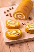 Pumpkin,lemon curd and hazelnut rolled log cake