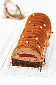 Brownie,milk chocolate mousse,caramel and cranberry heart log cake