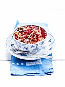 Salad with grated carrots, pomegranate, beetroot, sunflower seeds and pine nuts