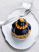 Crab savoury Religieuse with squid ink frosting