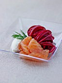 Thinly sliced smoked salmon,beetroot spaghetti and horseradish sauce