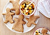 Gingerbread men with stewed diced apples,pears and apricots